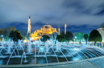 Sultanahmet fountain at night with Blue Mosque on background
