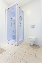 Clean toilet with white walls