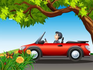 A man driving a red car