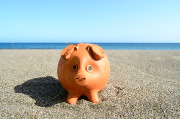 Coin Bank on Sand