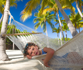 Child in hammock on vacation