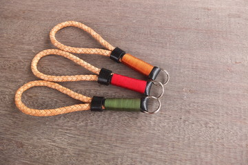 Handmade leather keychain on wood