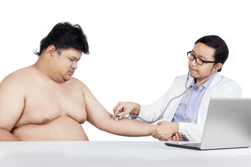 Doctor checking patient heartbeat