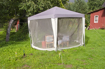 summer house tent with mosquito protection in farm yard