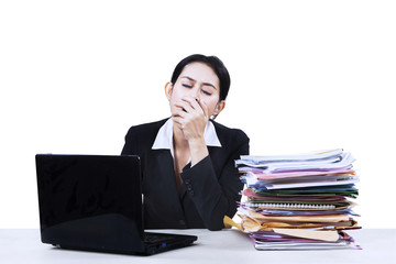 Exhausted businesswoman yawning isolated