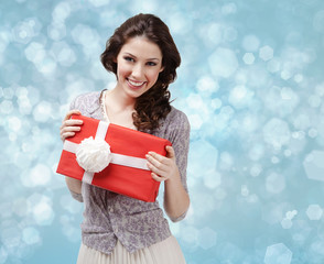 Attractive woman hands a present