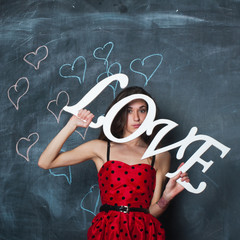 girl holding LOVE word