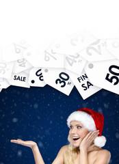 Pretty woman in Christmas cap shows seasonal discount