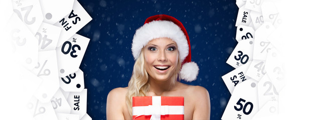 Pretty woman in Christmas cap hands item of the day