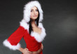 canvas print picture - Portrait woman wearing santa clause costume on black