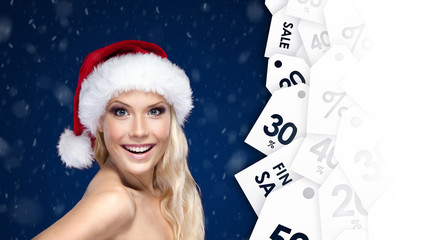 Beautiful woman in Christmas cap with good offer for discount