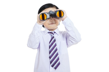 Little businessman using binoculars - isolated