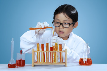 Little chemist mixes the chemical fluid