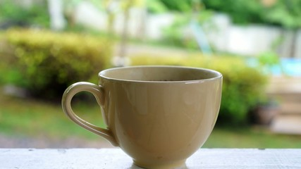 Cup of Hot Coffee with Steam Outdoors.