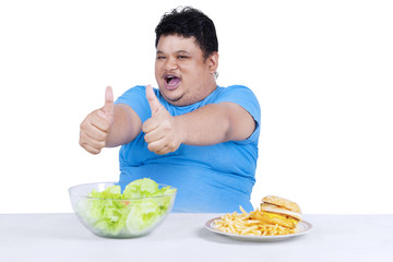 Man showing healthy and unhealthy food 3