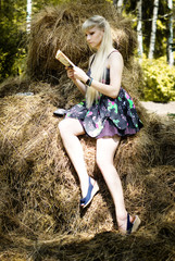 Beautiful girl reading in the woods