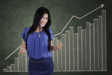 Successful woman and growth business chart