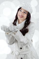 Sweet girl holding snow
