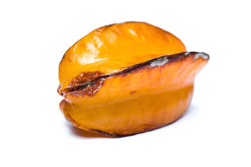 over-ripe starfruit on a white background