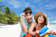 Couple packs up suitcase with clothing for honeymoon trip