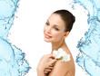 Portrait of naked girl handing white orchid in water splash