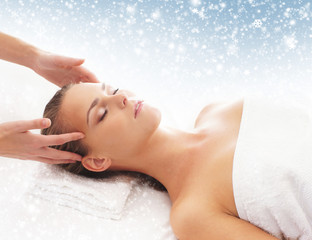 awoman getting massage treatment on a snowy background