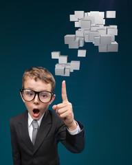 Cheerful boy businessman has idea