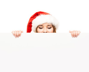 Young and attractive teenager girl in a Christmas hat
