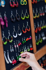 Choosing earrings in a shop