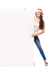 Teenager girl in a Christmas hat with a blank billboard