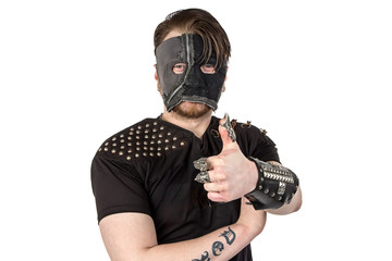 Photo of the man in mask with thumb