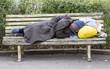 Leinwanddruck Bild - Homeless man sleeping on a bench
