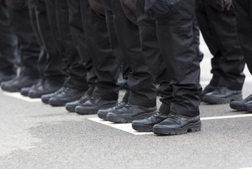 Policemen legs and boots