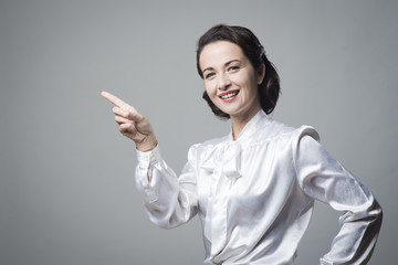 Attractive vintage woman pointing up