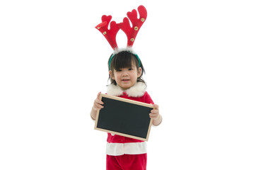 Cute asian baby wearing santa costume holding blackboard