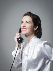 Confident vintage secretary on the phone