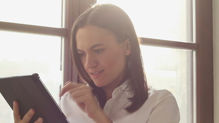 Successful businesswoman with tablet computer