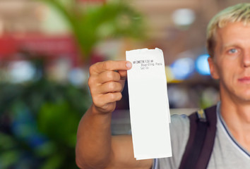 passenger holding a ticket in her hand