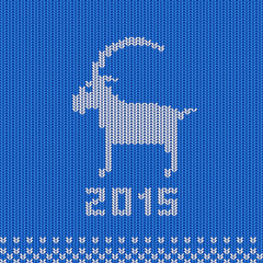 Knitted Background with a Goat - a Symbol of 2015