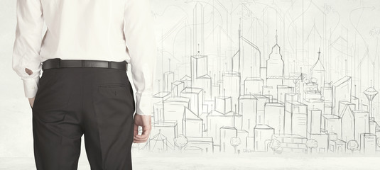 Businessman with drawn city view