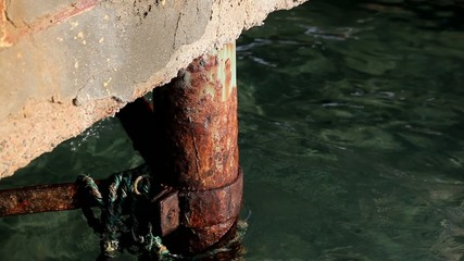 Rusty pile in seawater