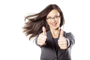 young businesswoman with the wind in her hair showing thumbs up