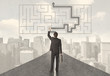 Businessman looking at road with maze and solution