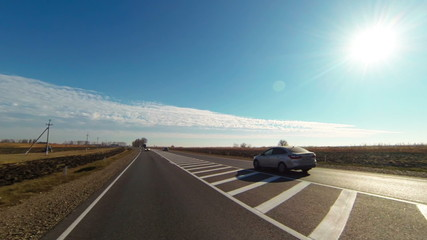 Highway With Cars Under the Blue Sky and Sun