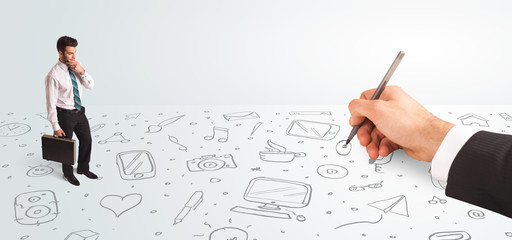 Little businessman looking at hand drawn icons and symbols