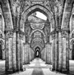 Historic ruins of abandoned abbey in black and white - 73567171