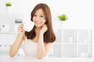 happy asian young drinking coffee