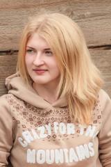 Portrait of green-eyed girl wearing wool sweater