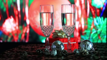 Glasses of champagne on background of New Year tree