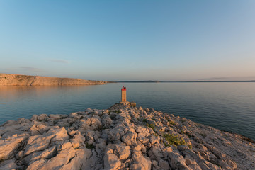 Lighthouse in bay near Pag bridge